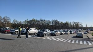 Photo of cars in lines ready to receive the COVID vaccine.